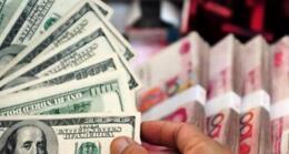 人民币兑美元中间价调贬90个基点,报6.6779